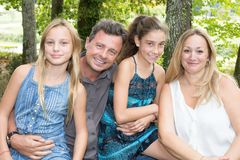 Excited Family Standing Outside garden Home. Portrait Of Excited Family Standing Outside garden Home Stock Image