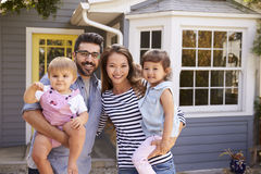 Portrait Of Excited Family Standing Outside New Home Royalty Free Stock Images