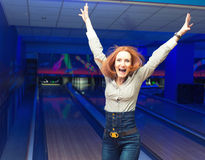 Excited girl in a bowling. Portrait of excited girl in a bowling alley Stock Photo