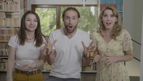 Portrait of excited group of friends yelling with wide open mouth full of amazement gesturing with palms wow reaction concept -. Portrait of excited group of stock video footage