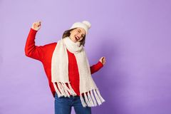Happy young woman isolated over purple background stock images