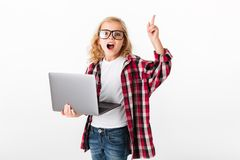 Portrait of an excited little girl ib eyeglasses Stock Image