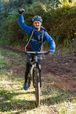 Portrait of excited male mountain biker in the forest Stock Photo
