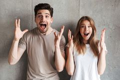 Portrait of excited people man and woman in basic clothing shout. Portrait of excited people men and women in basic clothing shouting and raising hands up with royalty free stock photos