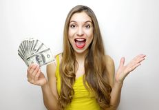 Portrait of excited pretty girl looking at camera with bunch of money banknotes isolated over white background stock photos