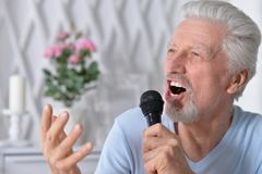Excited senior man holding  microphone Stock Photography