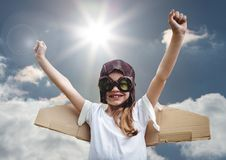Portrait of excited smiling kid pretending to be a pilot against bright sunlight background Royalty Free Stock Photography