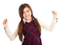 Portrait of excited student  with arms raised. Against white background Royalty Free Stock Photo
