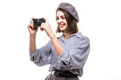 Portrait of an excited woman wearing beret holding photo camera over white background. Portrait of an excited woman wearing beret holding photo camera isolated stock photography
