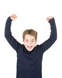 Portrait of an excited young boy with raised hands stock images