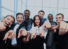 Portrait of excited young business people pointing at you. Stock Photo