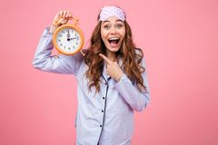 Portrait of an excited young girl dressed in pajamas Royalty Free Stock Images