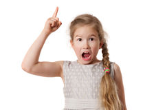 Portrait of excited young girl pointing finger up Stock Image
