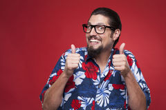 Portrait of an excited young man in Hawaiian shirt gesturing thu Royalty Free Stock Photo