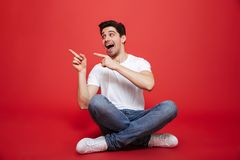 Portrait of an excited young man in white t-shirt Royalty Free Stock Photography