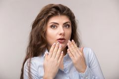 Portrait of excited young woman with hands gesture royalty free stock photo