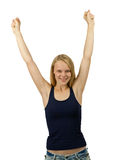 Portrait of an excited young woman with hands up Stock Photo