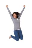 Portrait of excited young woman jumping stock photos