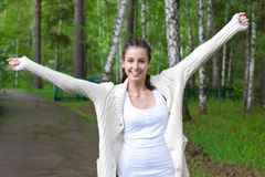 Portrait of excited young woman outdoors Royalty Free Stock Image