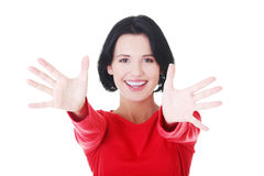 Woman pointing with both hands towards the camera Royalty Free Stock Photo
