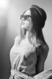 Portrait of exciting beautiful young lady in 3d. Picture of beautiful exciting young lady in 3d glasses looking up. Black and white photography Royalty Free Stock Photography