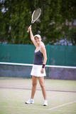 Portrait of Exclaiming Professional Tennis Player On Court Outdo. Ors Holding Racquet Up. Positive Expression. Vertical image Composition Royalty Free Stock Photography