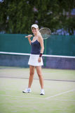 Portrait of Exclaiming Professional Tennis Player On Court Outdo Royalty Free Stock Image