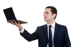 Portrait of executive holding laptop up high Royalty Free Stock Photos