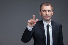 Portrait of executive pointing finger gestures Stock Image