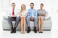 Portrait of executives waiting for interview. Portrait of executives waiting for job interview in office stock images