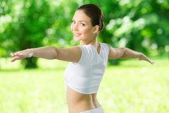 Portrait of exercising girl with outstretched arms Stock Images