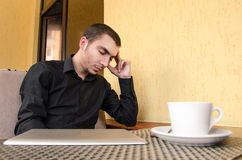 Portrait of exhausted worker sleeping on his desktop. Royalty Free Stock Photography