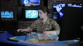 Portrait experienced officer woman in camouflage uniform, in military base, War center, working for laptop, stock video footage