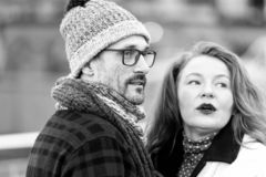 Portrait of expression couple talked on street. Couple looked off to strangers. Man in glasses and rude hair woman speaks to smb stock photos