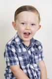 Portrait of an expressive beautiful blonde boy Royalty Free Stock Image