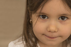 Portrait of expressive beautiful little girl. Smiling looking at the camera Stock Image