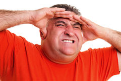 Portrait of an expressive man suffering from a severe headache Royalty Free Stock Photo