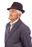 Portrait of an expressive old man with hat. Against white background royalty free stock photos