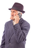 Portrait of an expressive senior talking on phone royalty free stock images