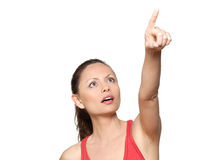 Portrait of expressive surprised woman pointing up. Portrait of cute expressive surprised woman pointing up in studio isolated on white background Stock Image