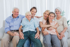 Portrait of an extended family sitting on couch Stock Images