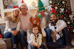 Portrait of extended family in Christmas hats royalty free stock photos