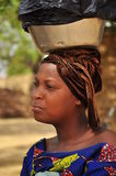 Portrait of an extremely beautiful african women. With blue traditinal clothing, carrying on her head. Niger, West Africa, village Hausa. Hausa: One of the stock photos