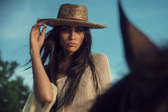 Portrait of a fabulous modelm riding a horse. Portrait of a fabulous modelm riding an arab horse Royalty Free Stock Image