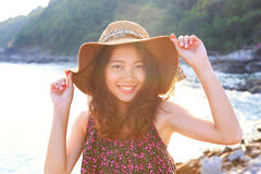 Portrait face of beautiful woman wearing wide straw hat standing Stock Photo