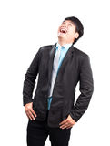 Portrait face of young asina business man laughing isolated on w Stock Image