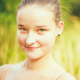 Portrait of face young beautiful girl woman on green outdoor background summer nature royalty free stock photo