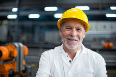 Portrait of factory engineer standing in bottle factory Royalty Free Stock Photography
