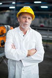 Portrait of factory engineer standing with his arms crossed Stock Image