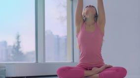 Portrait of fair-skinned smiling yoga woman enjoying lotus pose stock video